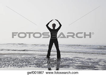 Picture of Belgium, Young woman meditating at North Sea gwf001867.
