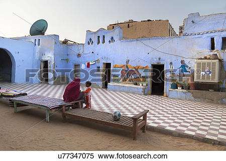 Stock Image of Egypt, Aswan, Nubian Desert. A mother and child in.