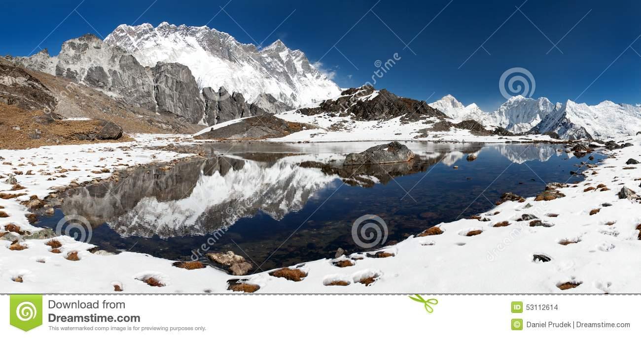 Panoramic View Of Lhotse And Nuptse With Lake Stock Photo.