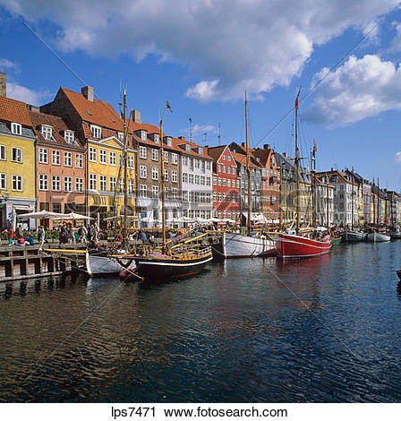 Stock Photography of moored sailboats and ancient houses nyhavn.