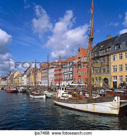 Pictures of moored sailboats and ancient houses nyhavn new harbour.