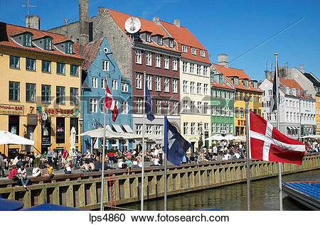 Stock Photography of FLAGS ANCIENT HOUSES AND WATERFRONT CAFE.