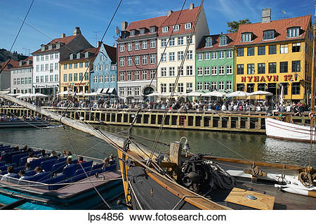 Stock Images of MOORED SAILBOATS ANCIENT HOUSES AND WATERFRONT.