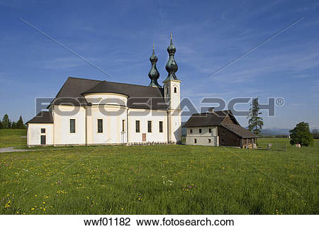 Stock Photo of Austria, Oberndorf, View of church in rural scene.