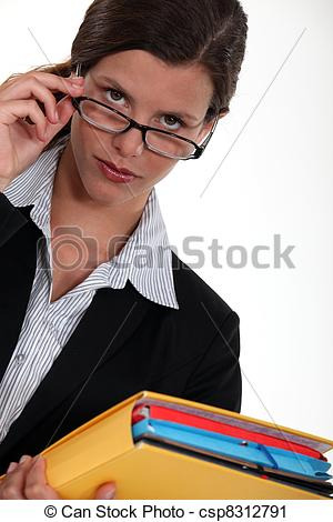 Stock Photography of Observant woman peering over her glasses.