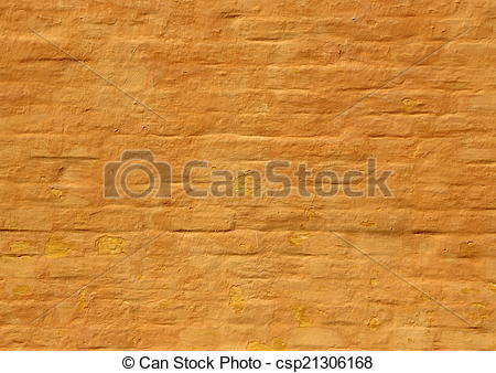 Stock Image of Old ochre yellow painted brick wall background.