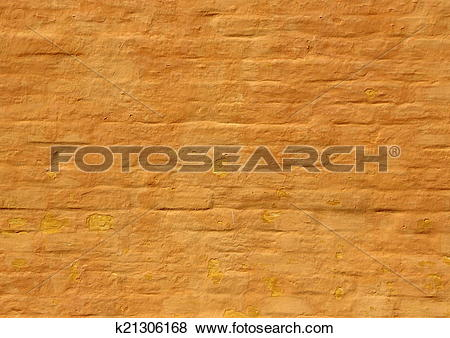 Pictures of Old ochre yellow painted brick wall background.