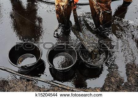 Stock Photo of clean up Crude oil stain k15204544.