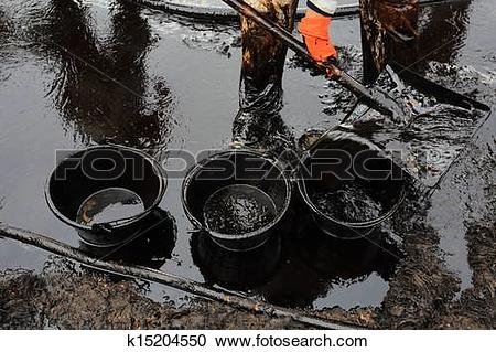 Stock Photography of clean up Crude oil stain k15204550.