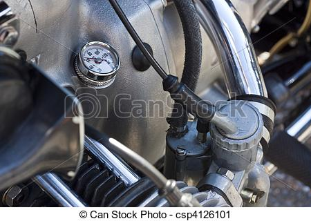 Stock Photography of Motorcycle crankcase with oil gauge.