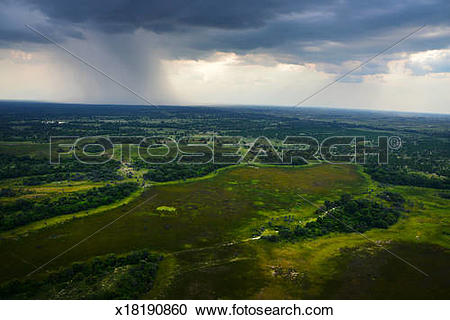 Stock Photography of Rain over the Okavango Delta x18190860.