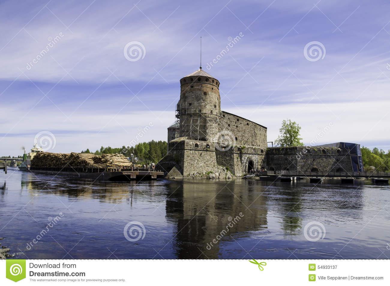 Cargo Ship Passing Olavinlinna Castle Stock Photo.