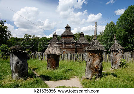 Stock Images of Medieval wooden church with old apiary ,Ukraine.
