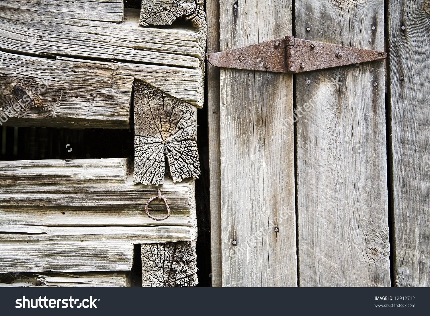 Dovetail Joint And Rusty Hinge In A Beam In An Old Barn In.