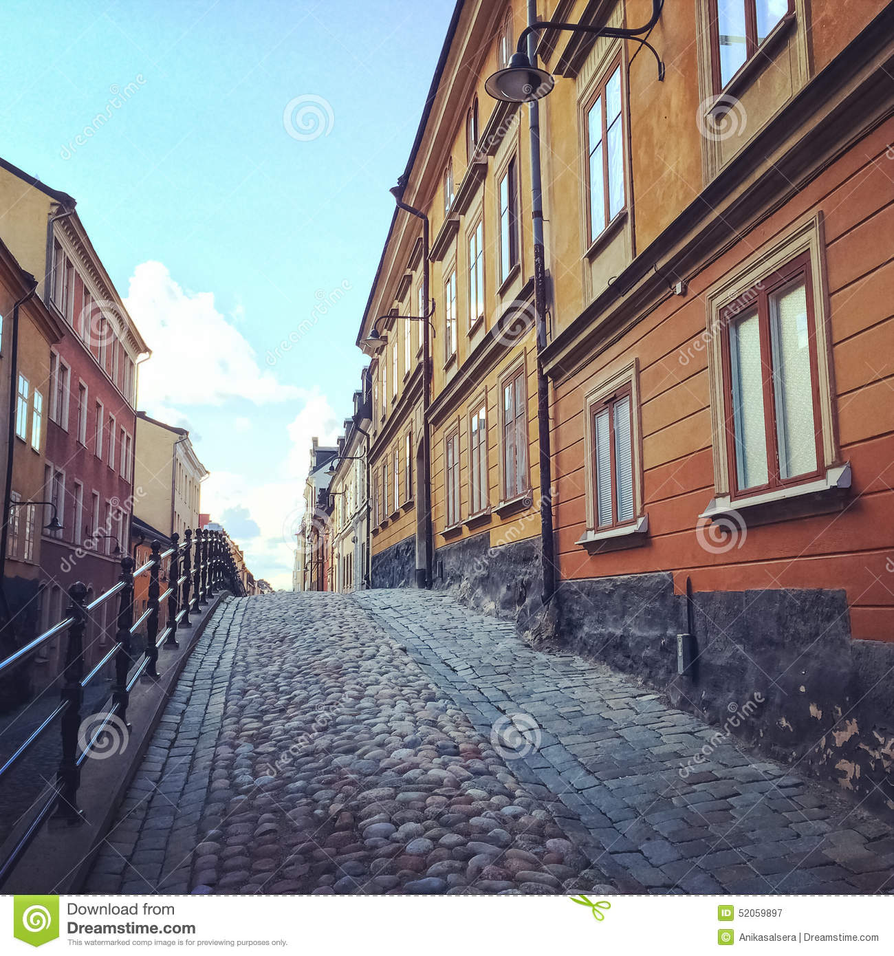 Cobblestone Street With Old Buildings In Stockholm Stock Photo.