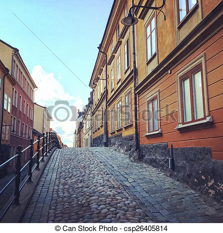Stock Photography of Cobblestone street with old buildings in.
