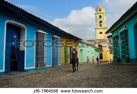 Stock Images of Trinidad Cuba old cobblestone street with cowboy.