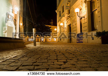 Stock Photography of Buildings along a cobblestone street, Old.