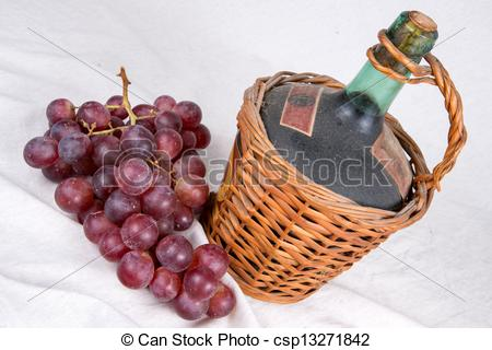 Stock Photo of Old Decanter of Red Wine with Grapes csp13271842.