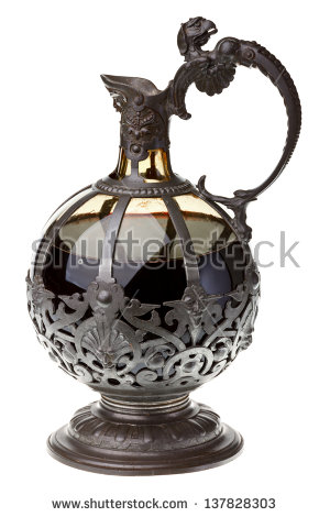 Old Glass Metal Claret Jug Decanter With Red Wine On White.