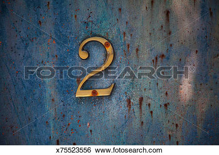 Stock Images of Number 2 sign on an aged painted metal door panel.