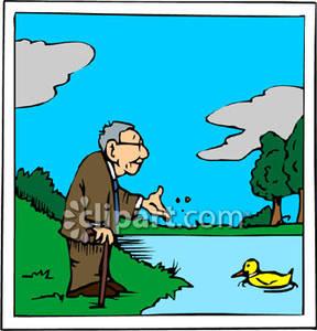 Man Feeding A Duck.