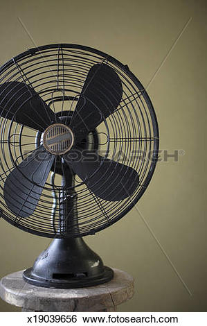 Stock Images of Antique electric fan on old chair x19039656.
