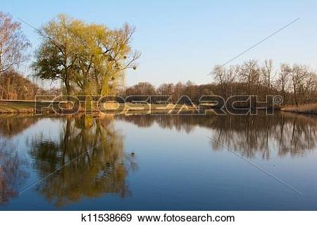 Stock Photograph of Old fishing hut with a wooden dock in the.