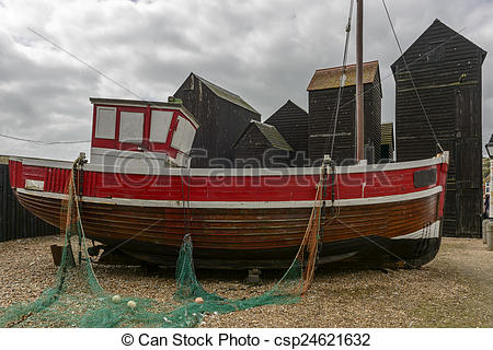 Stock Photos of old fish boat and fish net huts, Hastings.