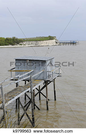 Stock Photo of Old Wood Fish Hut on Piles k9799563.