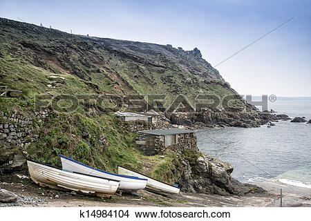 Stock Photo of Old fishing huts in landscape in Cornwall England.