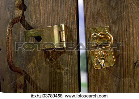 Pictures of Old wooden door with metal fittings and an open.