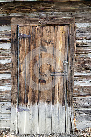 Old Horseshoe Hanging On The Door Handle Stock Photo.