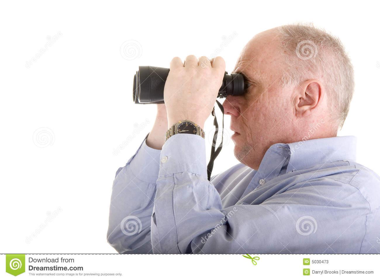 Old Man In Blue Shirt Looking Through Binoculars Stock Photos.