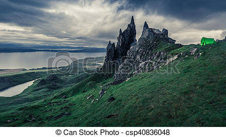 Stock Photo of Stormy clouds over tent in Old Man of Storr.