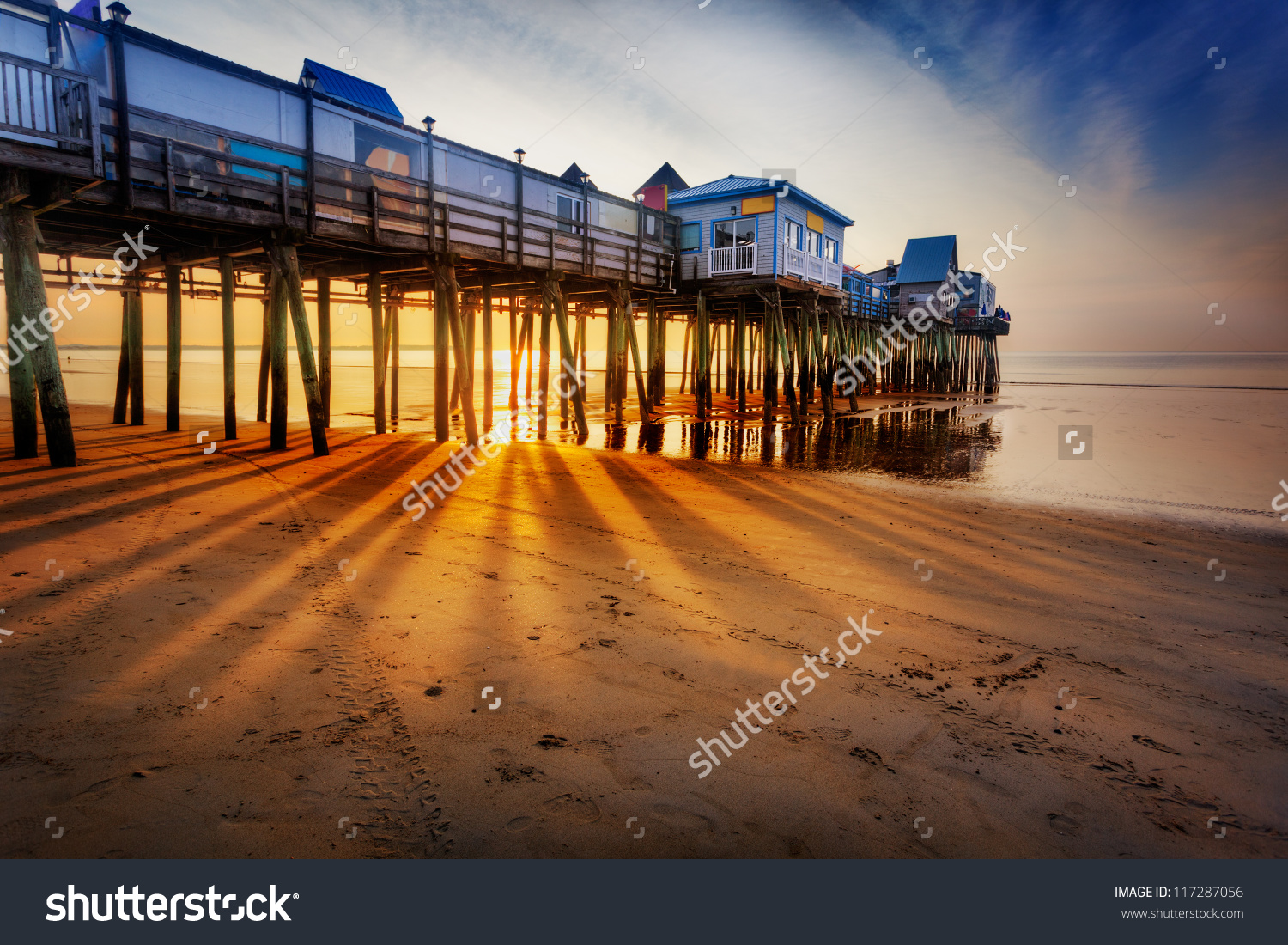 Old Orchard Beach Pier With Rays Through The Pilings At Low Tide.