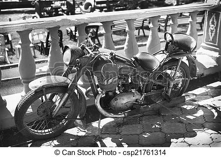 Stock Photography of old motorcycle at parapet.
