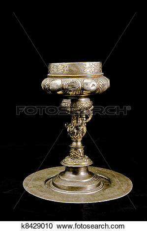 Stock Photography of Old silver cup isolated on black k8429010.