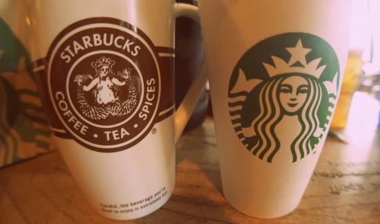 Old and new Starbucks logos.