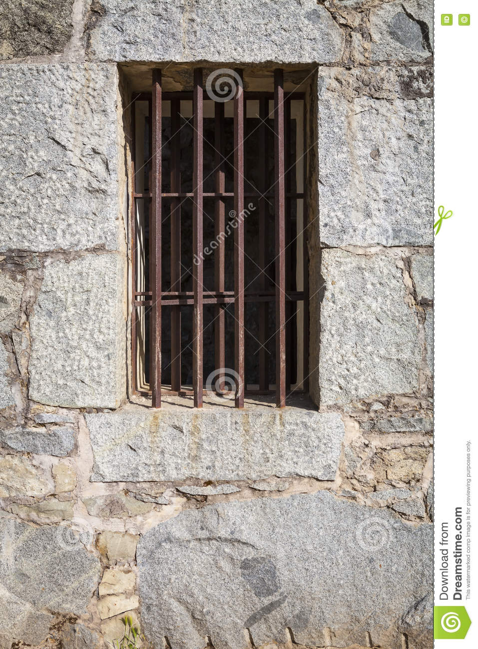 Iron Bars In Old Stone Jail Stock Photo.