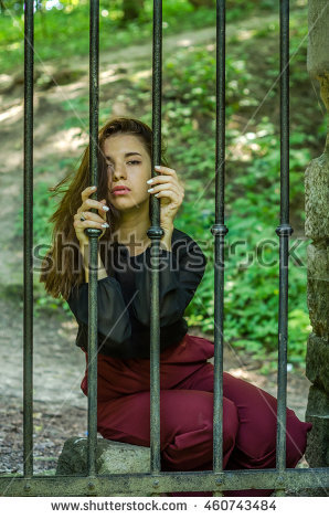 """woman_behind_fence"""" Stock Photos, Royalty."""