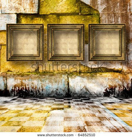 stock photo : The old stone room with wooden picture frames in.