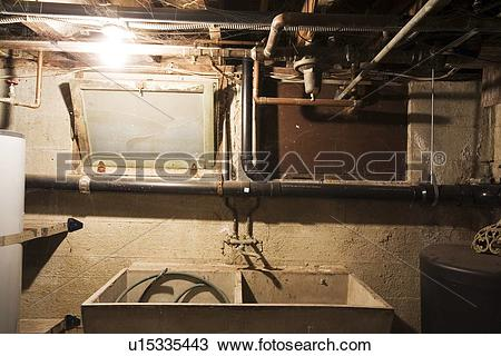 Stock Photo of Old utility tub in basement u15335443.