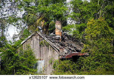 Picture of Old wooden house with brick chimney x12625107.