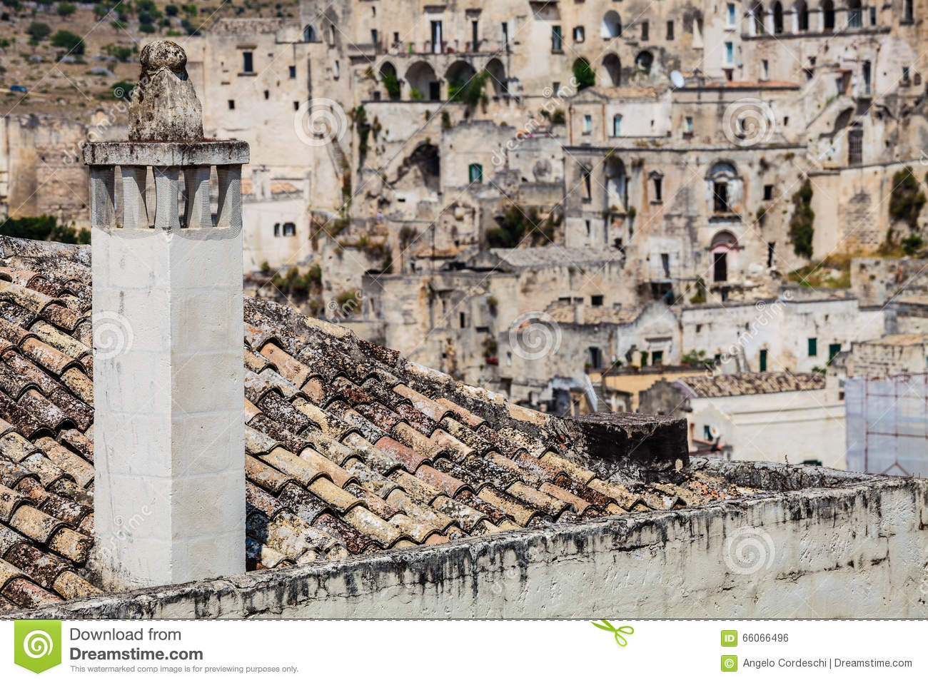 Ancient Italian Village. The Chimney Of The Fireplace On The Roof.