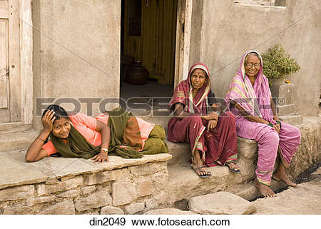 Stock Photograph of Two old women's and one young girl taking rest.
