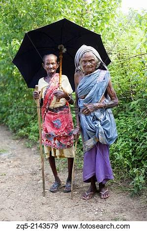 Stock Photograph of Old women with umbrellas. Santhal tribe.