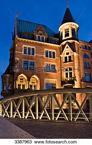 Stock Photo of Illuminated building and bridge in the old.