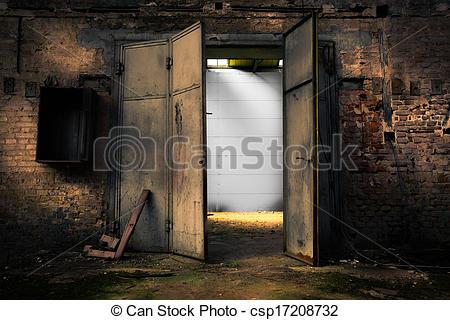 Stock Photos of rusty metal door in an abandoned warehouse.