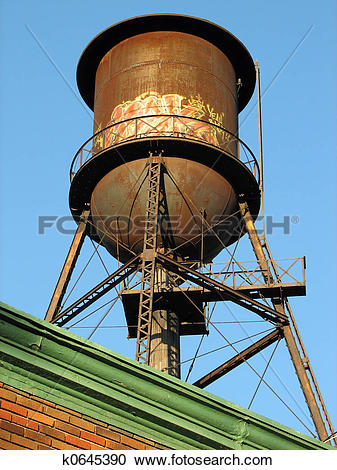 Stock Photography of Old water tower on the roof k0645390.
